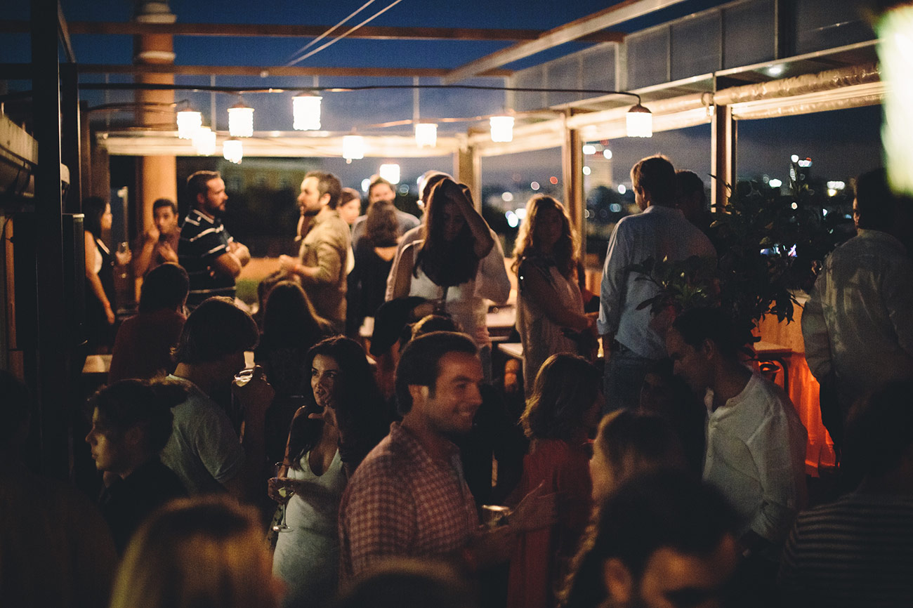 Group of people at a party, in The Insólito rooftop